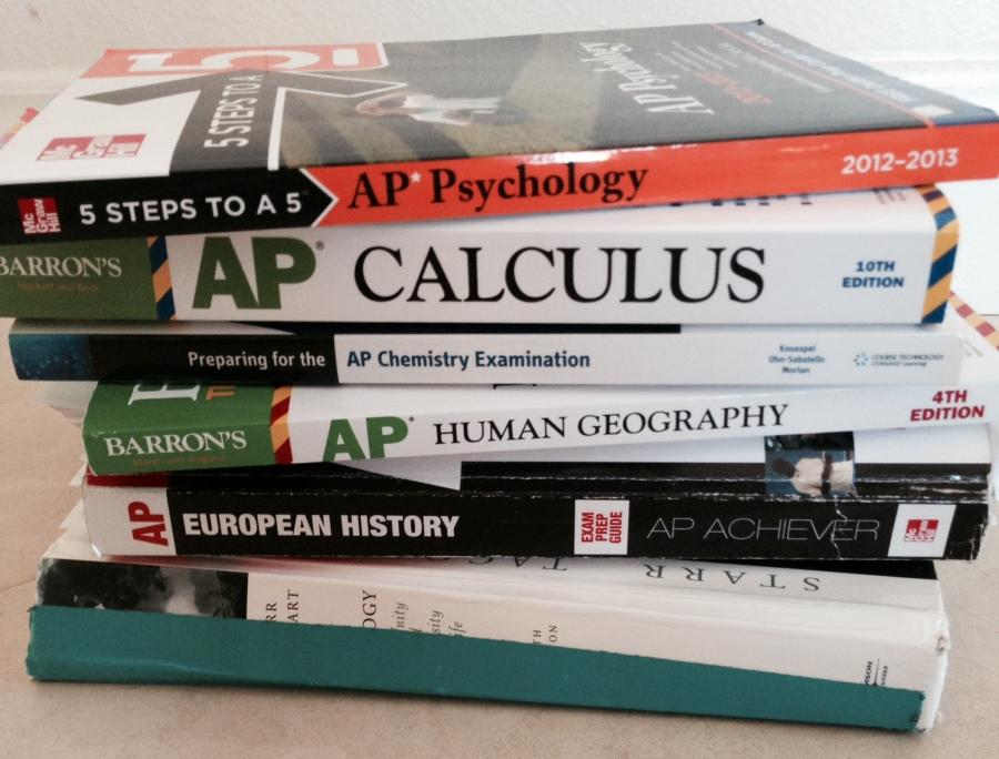 Displays a stack of AP test prep books