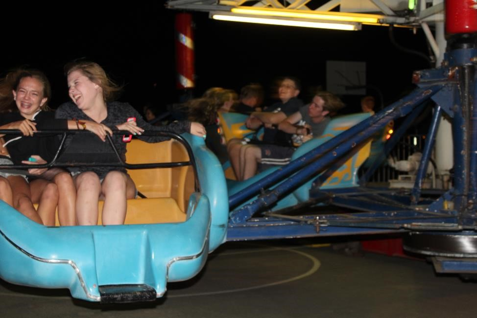Students enjoy riding on the Sizzler at the Hunger Games Homecoming Dance.