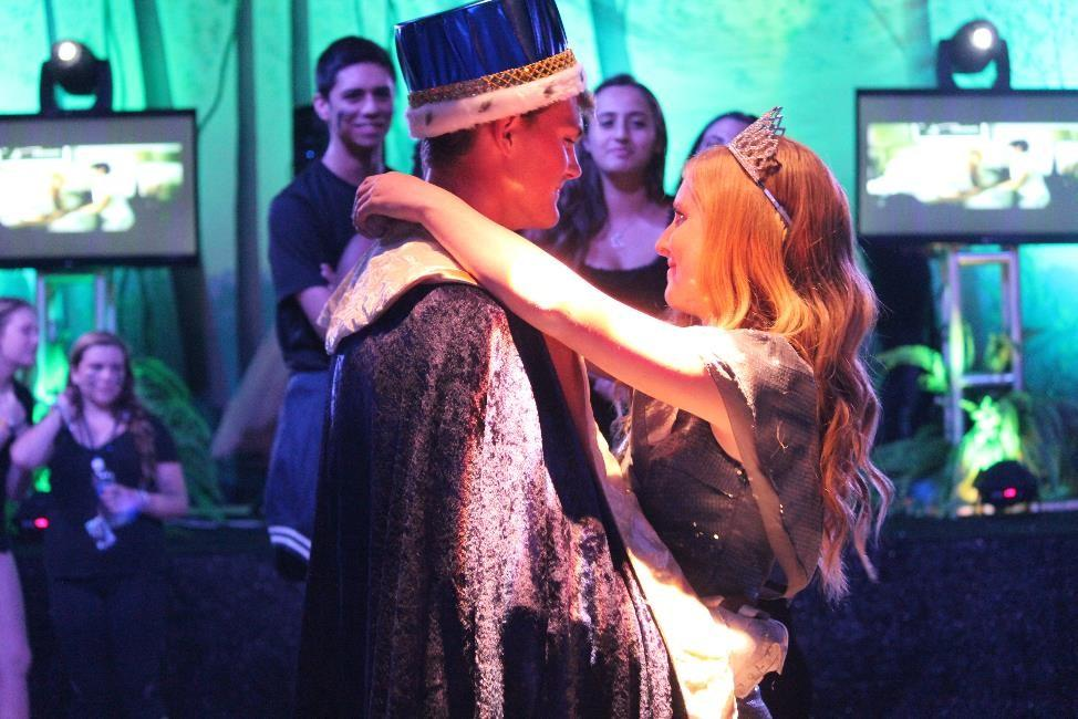 Homecoming+king+and+queen%2C+Jacob+Shalkevich+and+Stephanie+Rankin%2C+share+a+dance+at+the+Hunger+Games+Homecoming+Dance.