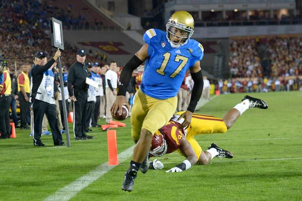 Quarterback Brett Hundley marches in for a touchdown to put the Bruins up by 24, but is not yet sure if he will recommit for his junior season.
