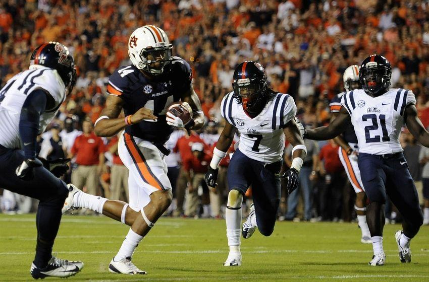 Auburn's Nick Marshall runs past the Ole Miss defense for a touchdown in the second quarter.