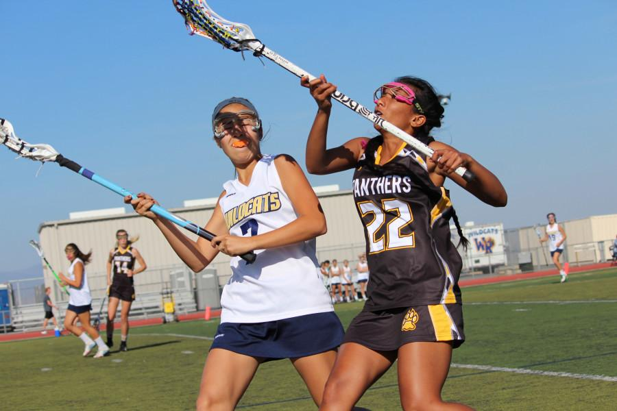 Junior Emma Doyle battles it out with the Panthers on Wednesday, April 1.