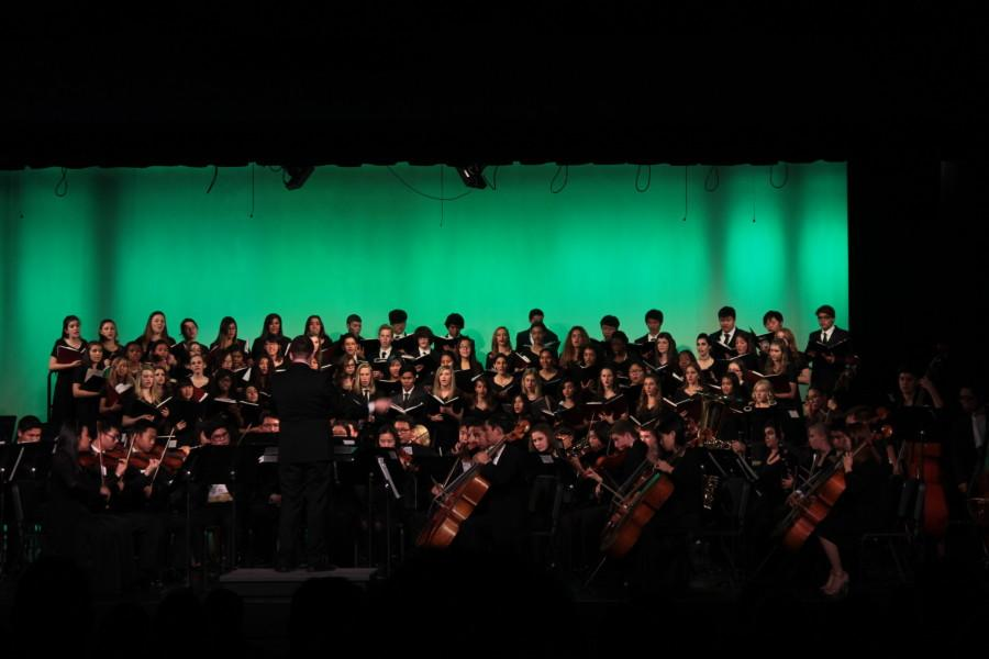 Choir and orchestra deck the halls with sounds of jolly
