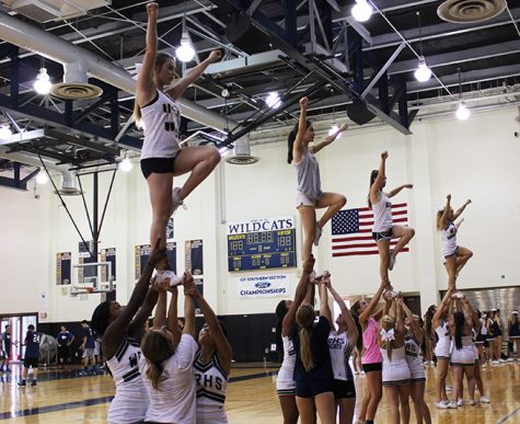This advanced stunt is called a liberty. It requires perfect footing, stability and synchronization. The flyers have to balance on one leg nearly seven feet in the air. This also takes maximum strength from the bases in order to hold a girl above their head for several counts. If the bases are not on the same count, the flyer will quickly fill the gap of space between herself, her bases, and the gym floor.