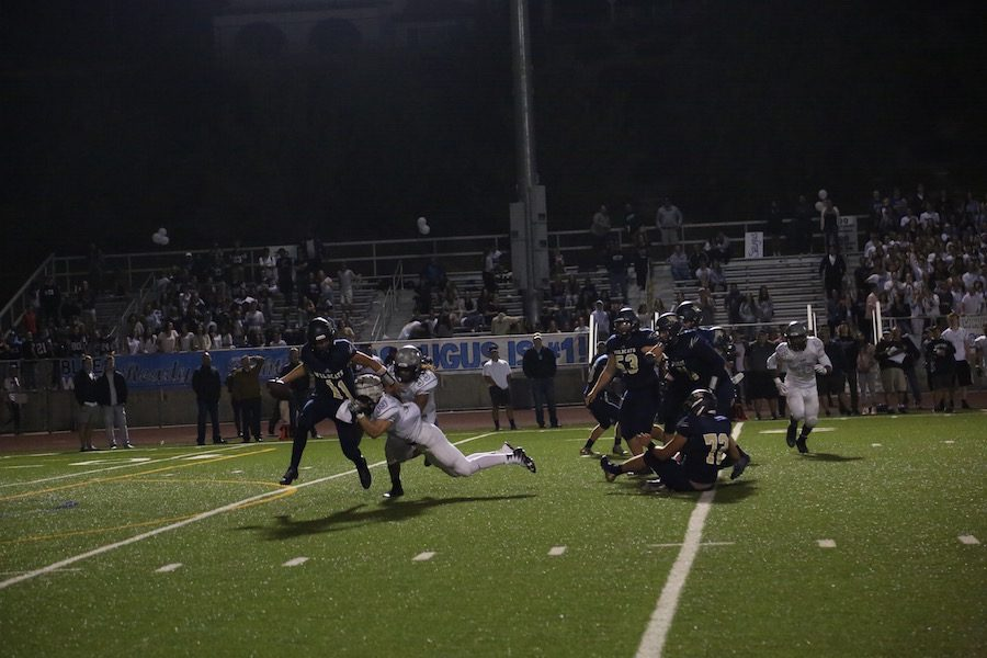 Wyatt Eget breaks two tackles and makes a great pass out of the pocket.