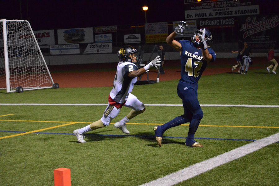 Camacho attempts to haul in a TD pass from Eget.