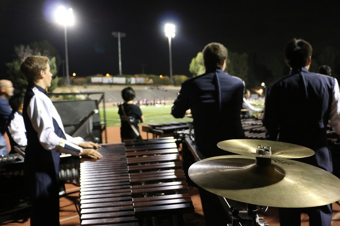 Percussion+watches+intently+at+another+school%27s+production+while+they+wait+for+their+turn.+