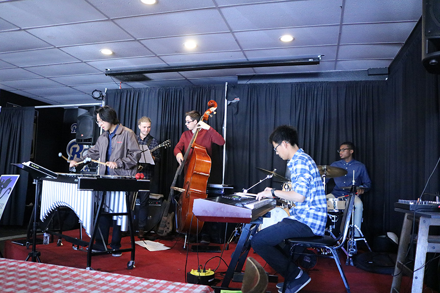 West Ranch Jazz Combo performs on stage at Vincenzo's Pizza