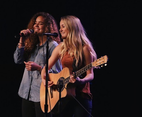 Marley (on left) singing for open mic