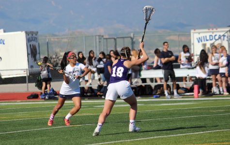 Varsity Girls Lacrosse Team Crushes Vikings in First League Game