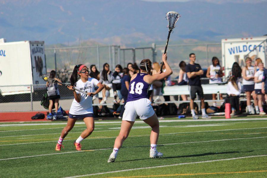 Varsity Girls Lacrosse Team Crushes Vikings in First League Game