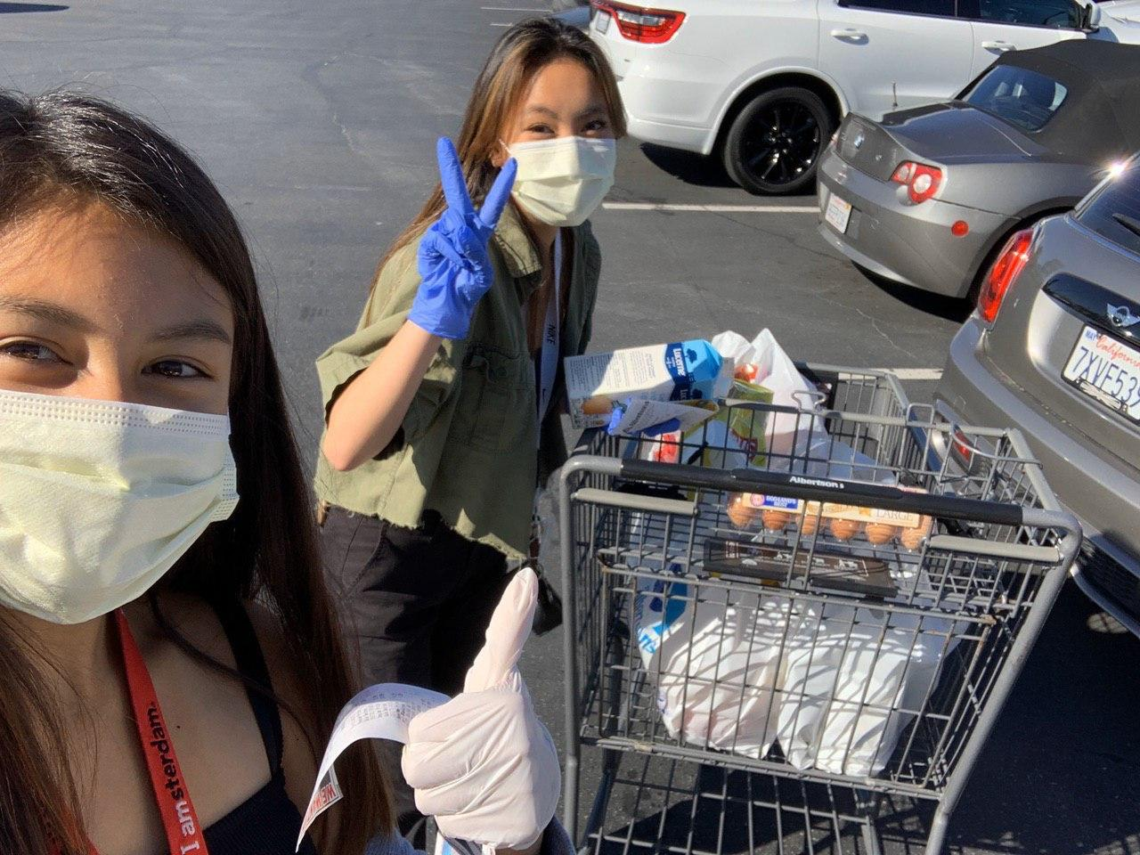 "Christina Riel and Krysta Mendoza, both juniors at West Ranch. ""Krysta and I were shopping for an order from Albertsons for two families who ordered through Six Feet Supplies"" said Riel. Picture provided by Caleb Kim."